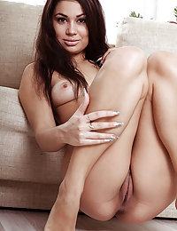 Zola slowly strips her lingerie as she displays her sexy, tanned body.