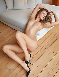 Kalisy shows off her sexy legs and tight ass as she poses on the bed.