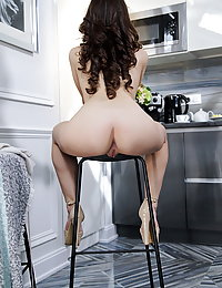 Hayli Sanders flaunts her delectable pussy as she strips in the kitchen.