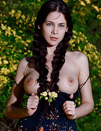 Seductive Martina Mink shows off her luscious body and big tits as she strips outdoors.