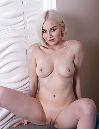 Kery shows off her luscious body and beautiful tits as she strips on the couch.