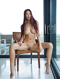 Paula Shy shows off her naked body and sweet ass on the chair.