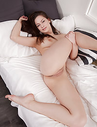 Marion spreads her legs wide open baring her delectable pussy on the bed.