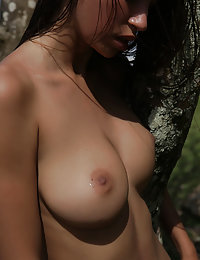 Elin strips outdoors baring her big titties and smooth pussy.