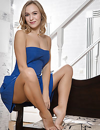 Aislin strips her blue dress on the couch baring her amazing body and creamy pussy.