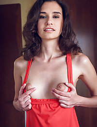 Cristin strips in the bedroom baring her petite body.
