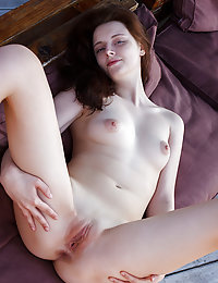 Redhead Sienna displays her naked, creamy body and pink pussy in the balcony.