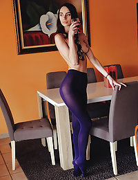 Dita V poses on the table as she bares her sexy, slender body.