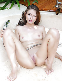 Hilary C displays her sexy, wet body as she dips in the tub.