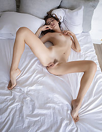 Gracie sensually strips on the bed baring her tight ass and sweet pussy.