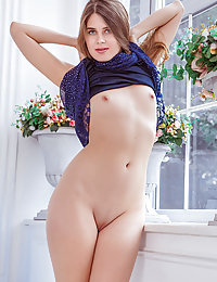 Luna Pica strips by the window as she flaunts her smooth, slender body.